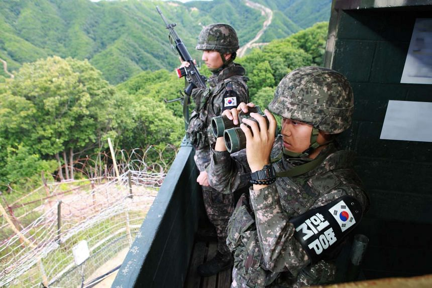 South Korean soldiers standing guard at a guard post in the Demilitarized Zone (DMZ) separating North and South Korea, in Hwacheon on Aug 26, 2015.