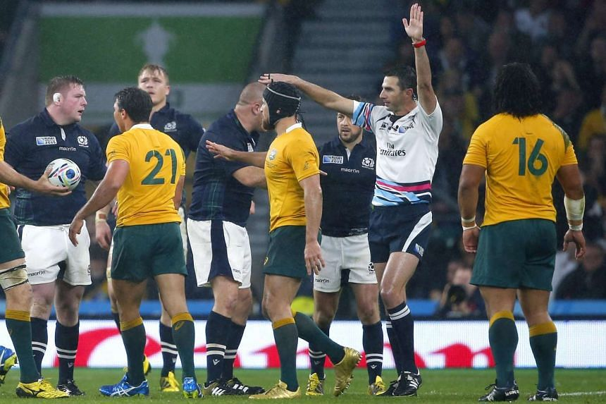 Referee Craig Joubert (in white) awarding a penalty against Scotland's Jon Welsh (left) in the last minute of the Rugby World Cup match against Australia, at Twickenham on Oct 20, 2015.