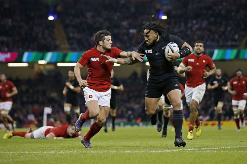 New Zealand's Ma'a Nonu fends off France's Brice Dulin during their Rugby World Cup quarter-final match at the Millennium Stadium on Oct 17, 2015.