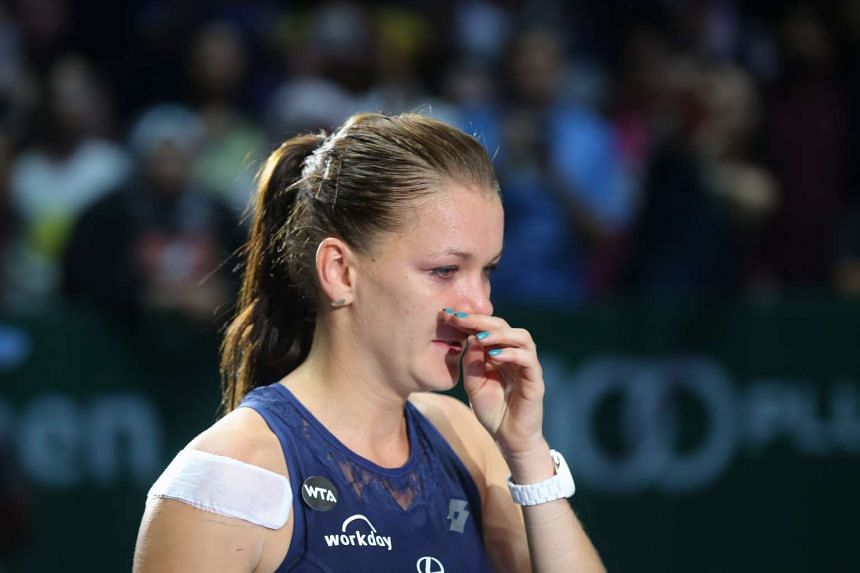 Agnieszka Radwanska crying after she won the women's singles final at the WTA Finals at the Singapore Indoor Stadium on Nov 1, 2015.