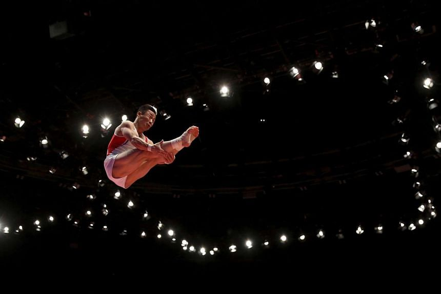 North Korea's Ri Se Gwang competes in the vault during the men's apparatus final.