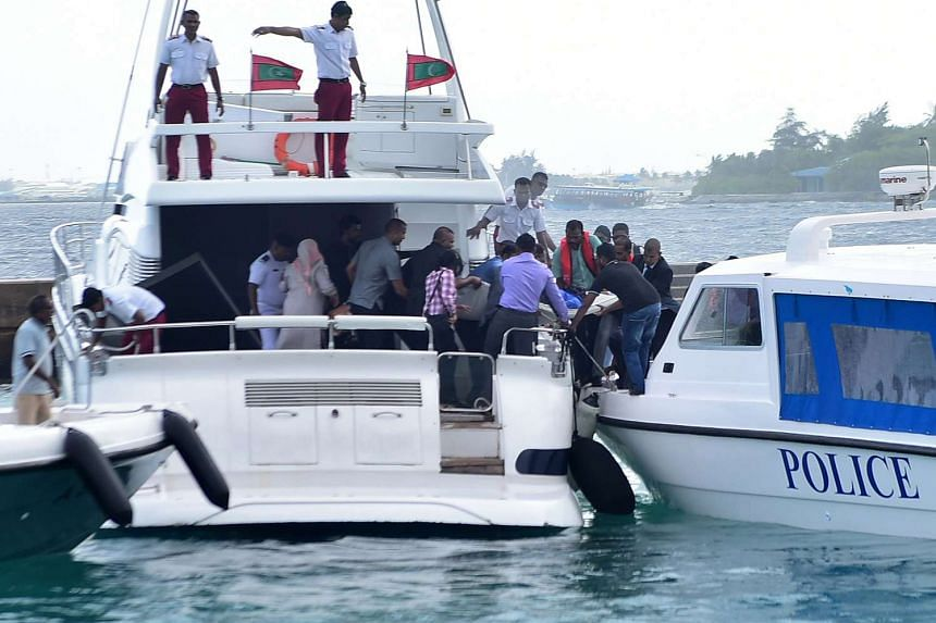 An injured person is transferred after the blast to an accompanying police speedboat on Sept 28, 2015.