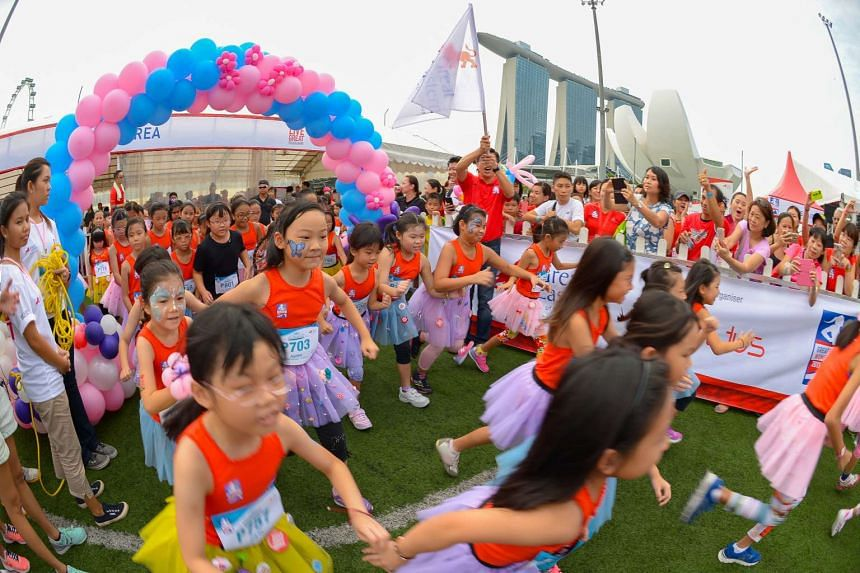 Girls wearing tutus participating in the 100m Princess dash in the age 7-9 category at the Great Eastern Women's Run 2015 on Nov 1, 2015.