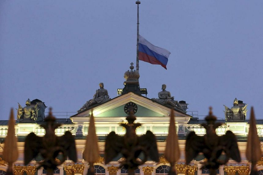 The Russian national flag flies at half-mast on the roof of the State Hermitage Museum in St Petersburg, Russia on Nov 1, 2015.