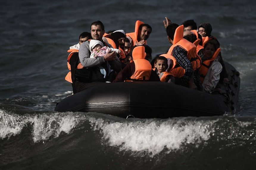Refugees and migrants arriving on the Greek island of Lesbos after crossing the Aegean Sea from Turkey by boat, on Oct 31, 2015.