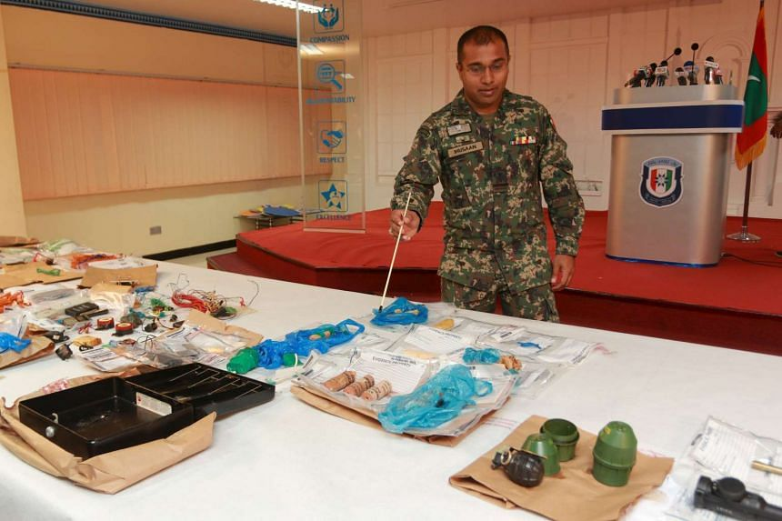 A Maldives soldier shows suspected bomb-making materials found on an island during investigations into an explosion on a speedboat transporting Maldives President Abdulla Yameen, in Hibalhidhoo, Maldives, on Oct 31, 2015.