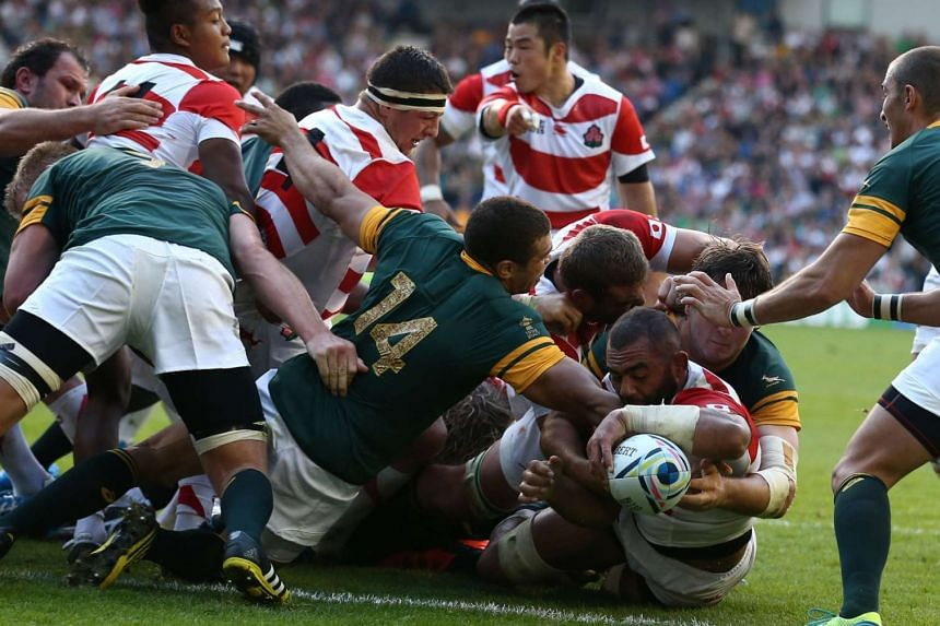 Japan's Michael Leitch (right) scoring a try during a Pool B match of the 2015 Rugby World Cup against South Africa at the Brighton community stadium in Brighton, south-east England, on Sept 19, 2015.