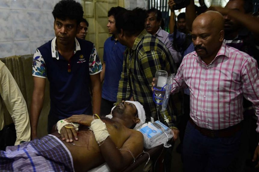 Bangladeshi publisher Ahmedur Rashid Chowdhury Tutul receiving treatment at the Dhaka medical college hospital after being attacked in the office of a publisher in Dhaka on Oct 31, 2015.