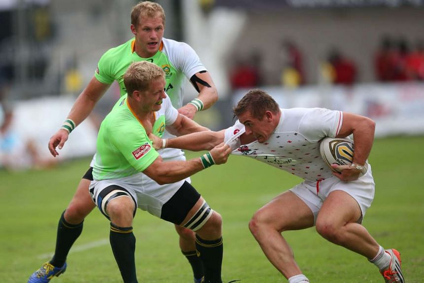 South Africa Sevens captain Kyle Brown (left) tackling an England player (right) at the Padang on Oct 31, 2015. The South Africa Sevens, led by Brown, won the Societe Generale Singapore Cricket Club International Rugby Sevens title on Nov 1, 2015.