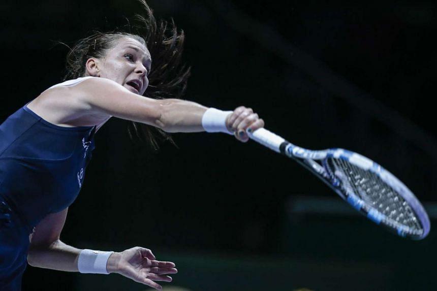 Agnieszka Radwanska of Poland hitting a shot to Petra Kvitova of the Czech Republic during their singles final match of the BNP Paribas WTA Finals, at the Singapore Indoor Stadium on Nov 1, 2015.