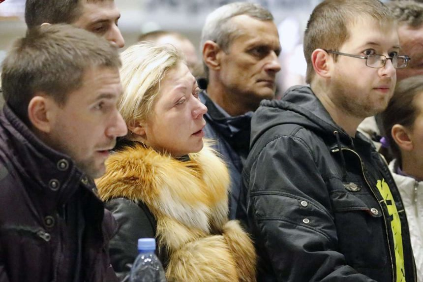 Relatives of passengers of MetroJet Airbus A321 wait at Pulkovo II international airport in St Petersburg, Russia.