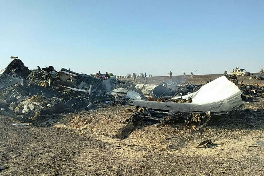 Debris from crashed Russian jet lies strewn across the sand at the site of the crash in Sinai, Egypt, Oct 31, 2015.