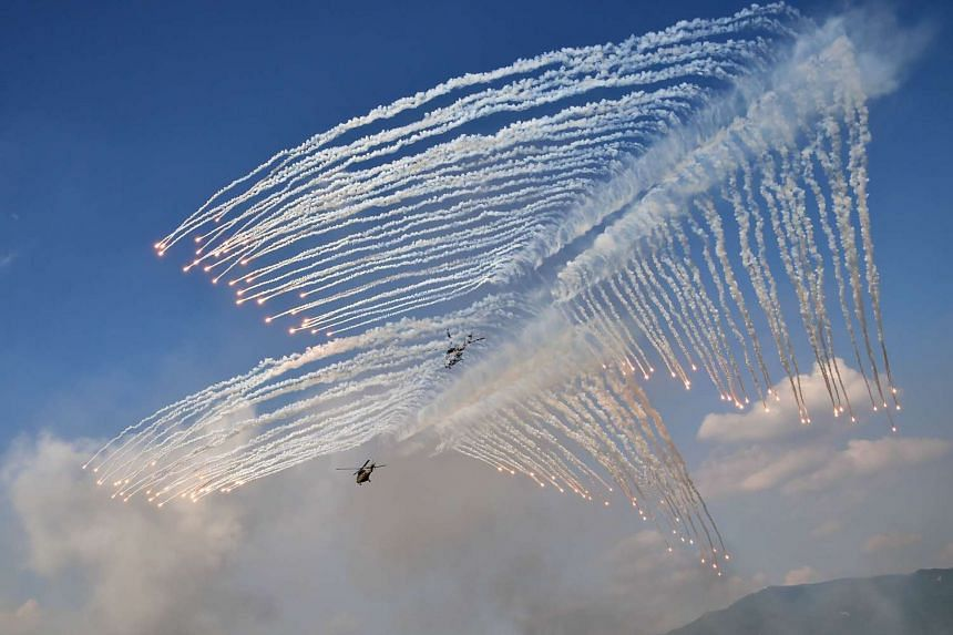 South Korean Army Surion helicopters firing flares during a joint live firing drill between South Korea and the US at the Seungjin Fire Training Field in Pocheon, 65 km northeast of Seoul, on Aug 28, 2015.