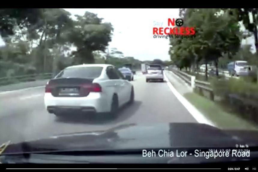 The white BMW was filmed weaving through traffic in this video posted on Facebook page Beh Chia Lor – Singapore Road.