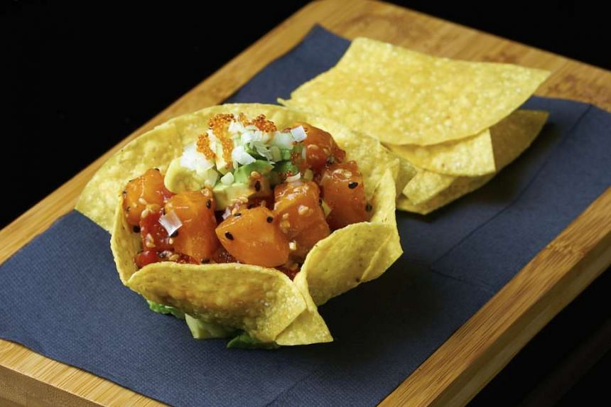 Poke served in a tortilla-chip bowl at Lokkee.