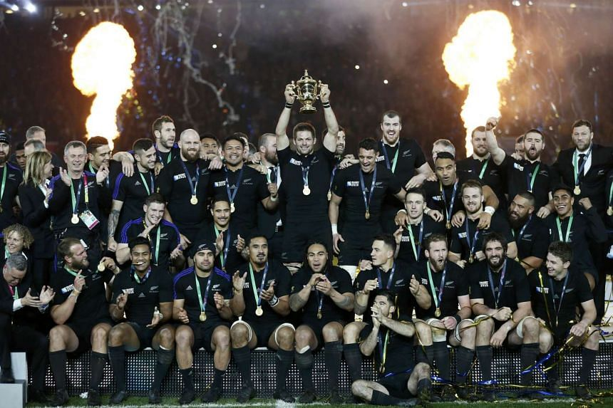 New Zealand's team celebrate with the Webb Ellis trophy after winning the Rugby World Cup Final against Australia.
