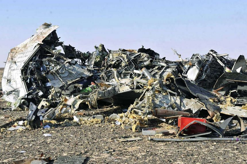 Debris from the crashed Russian jet lies strewn across the sand at the site of the crash in Sinai, Egypt.