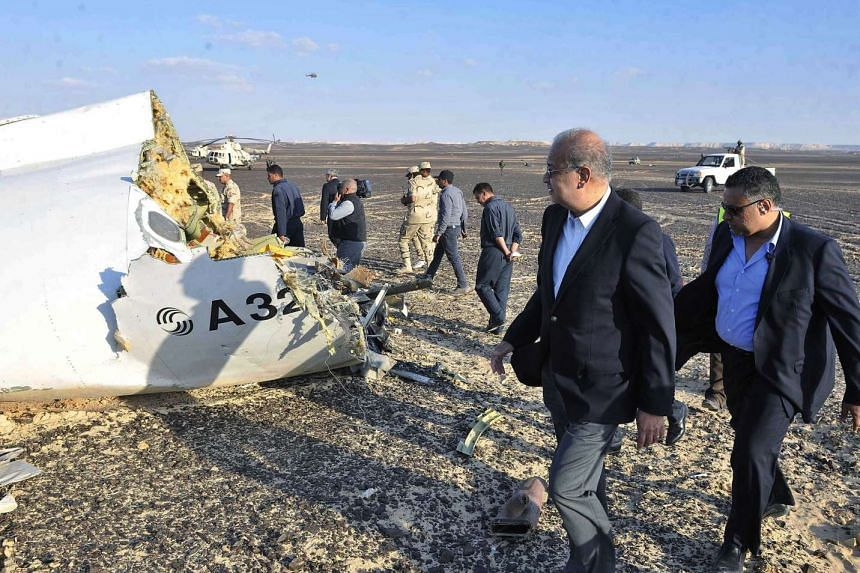 Egyptian Prime Minister Sherif Ismail (second right) examines the wreckage at the site of the Russian plane crash.