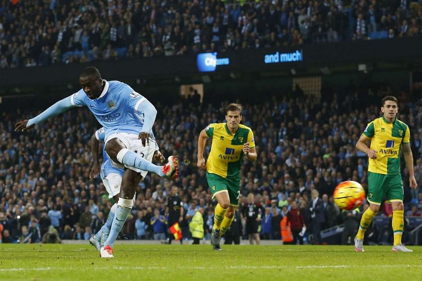 Manchester City's Ivorian midfielder Yaya Toure (L) scores their second goal from the penalty spot.