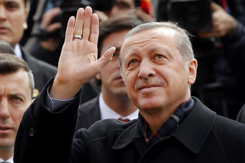 Turkish President Tayyip Erdogan waving to his supporters as he leaves a polling station in Istanbul, Turkey, on Nov 1, 2015.