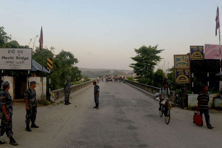 Nepalese security personnel guard an entry point to Nepal from India on the border.