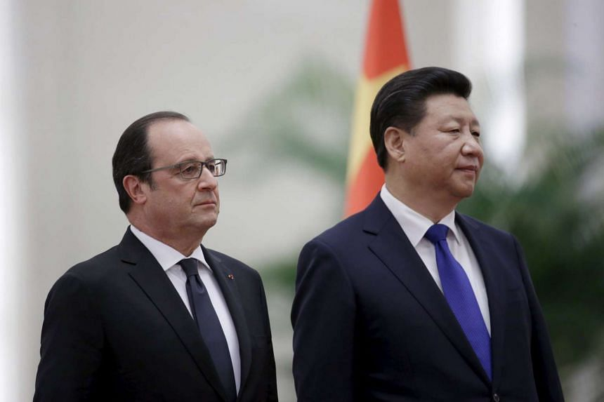 China's President Xi Jinping and his French counterpart Francois Hollande at the Great Hall of the People in Beijing on Nov 2, 2015.