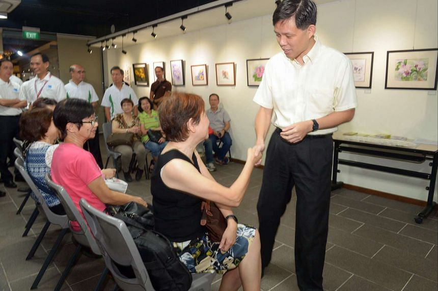 Minister Chan Chun Sing (right) greeting residents during a consultation session.
