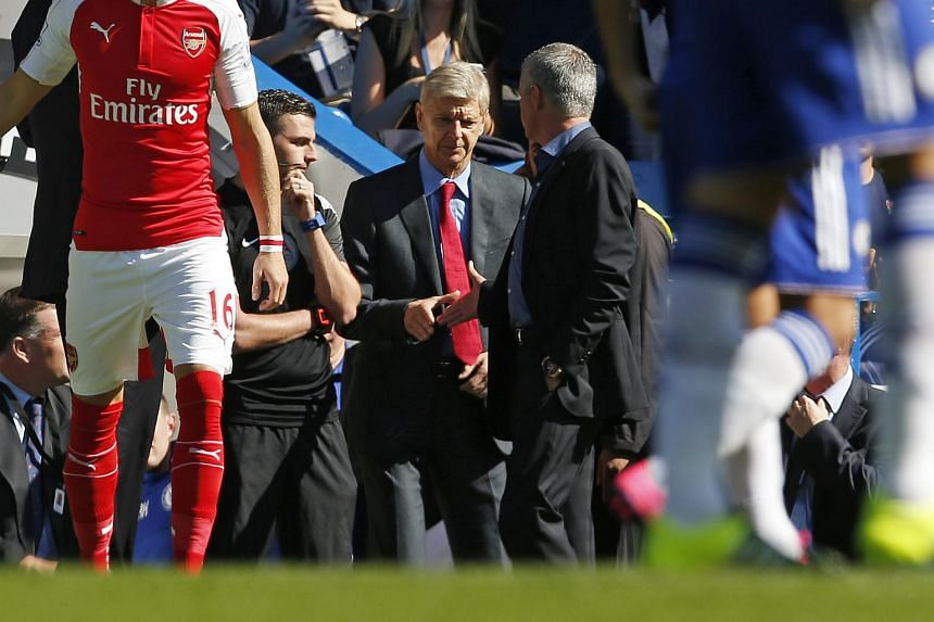 Jose Mourinho and Arsene Wenger shake hands before the match between Chelsea and Arsenal in September.