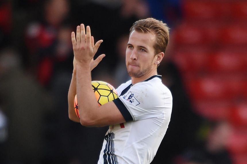 Tottenham's Harry Kane celebrates at full time with the matchball after completing his hat-trick  against AFC Bournemouth.