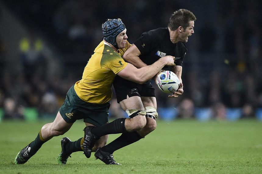 New Zealand's flanker and captain Richie McCaw (right) is tackled by Australia's David Pocock during the final match of the 2015 Rugby World Cup between New Zealand and Australia at Twickenham stadium, south west London, on Oct 31, 2015.