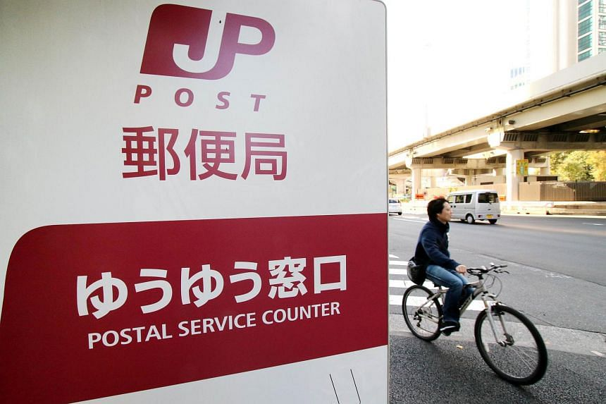 A cyclist passes a post office in Tokyo on Nov 1, 2015.