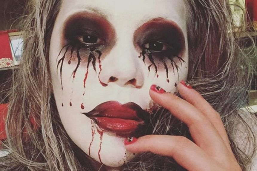 A photo Ms Leung Chai Yan, Hong Kong Chief Executive Leung Chun Ying's daughter, posted of herself at a Halloween party before she was filmed slapping her mother.
