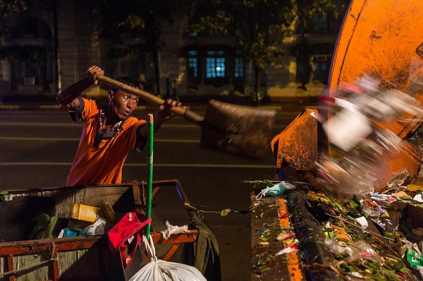 Mr U Tin Win, 50, is a night shift worker who collects trash in Kyauk Tadar township which one of the main areas of downtown Yangon.