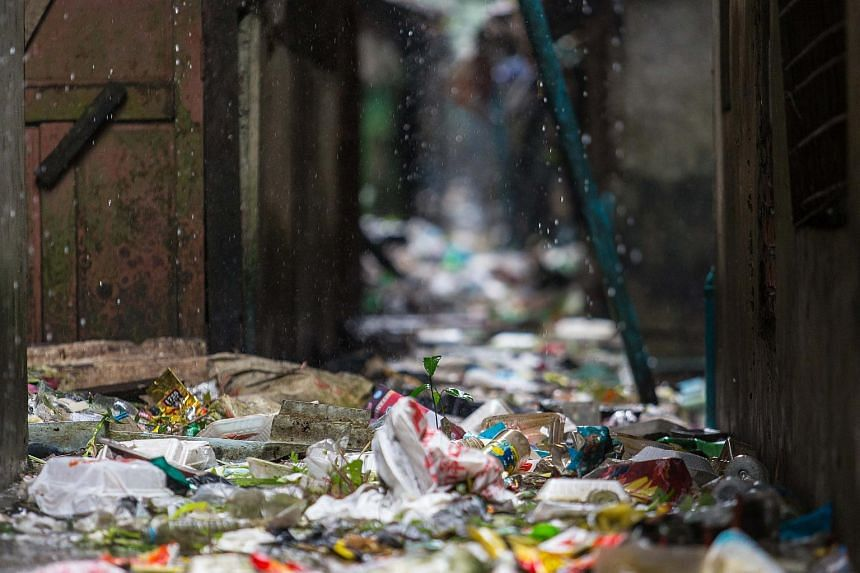 There are many back alleys Yangon that have become convenient dumping grounds for the residents.