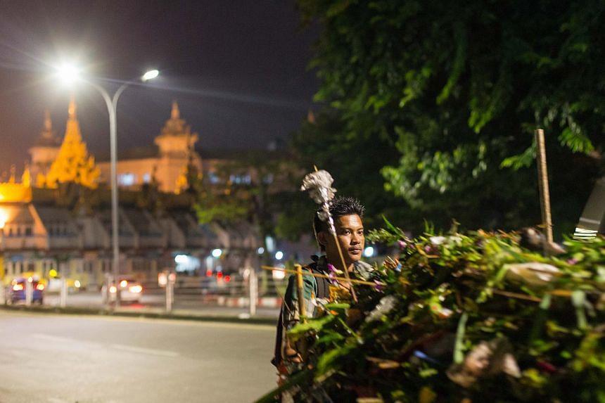 Mr Aung Moe, 24, works the night shift in Kyauk Tadar township in Yangon city.