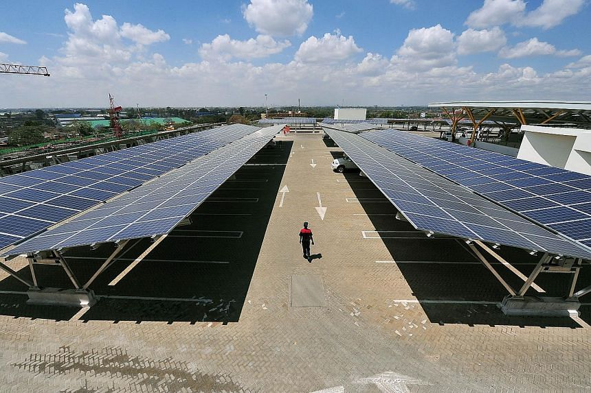 A carpark with rooftop solar panels that also help shade parked cars, at the Garden City Mall in Nairobi. The carpark, opened recently at the shopping mall, is Africa's largest solar carpark and aims to cut carbon emissions by 745 tonnes annually fro