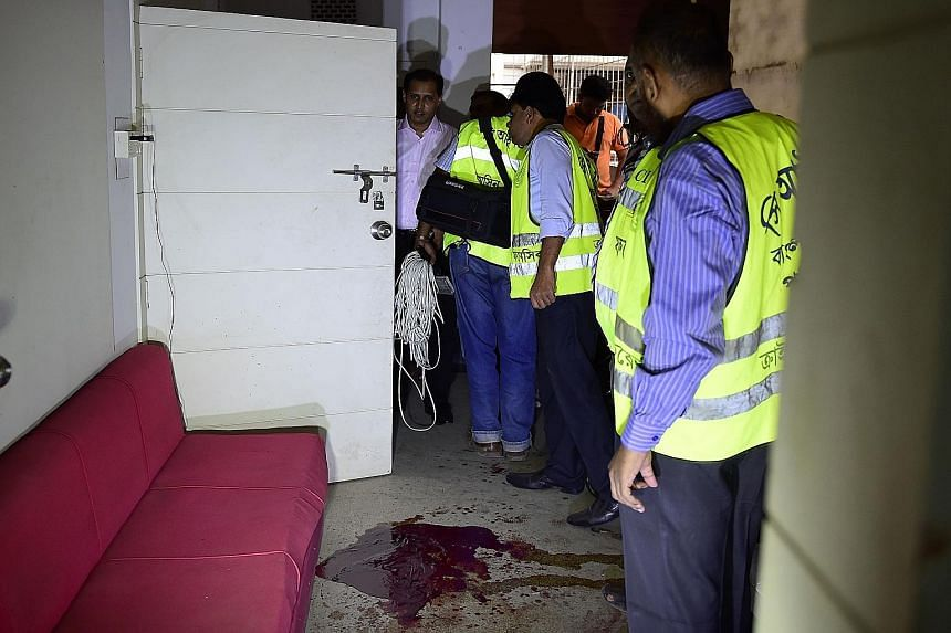 Bangladeshi police examining the scene of an attack on publisher Ahmedur Rashid Tutul, along with two secular bloggers, in an office in Dhaka on Saturday. The government has been accused of failing to halt the rise in deadly violence blamed on hardli