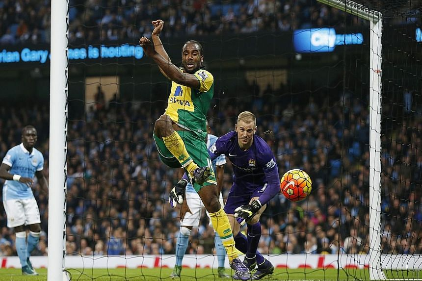 Norwich City's Cameron Jerome pounces on a fumble from Manchester City custodian Joe Hart to equalise the score at 1-1. But City earned an 89th-minute penalty, converted by Yaya Toure, to pick up the three points.