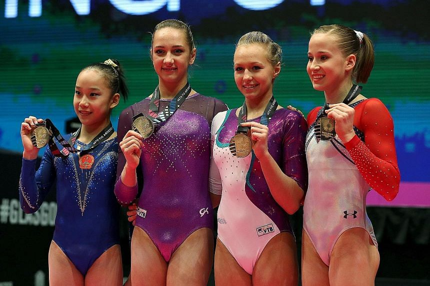 From left: Fan Yilin of China, Viktoria Komova of Russia, her compatriot Daria Spiridonova, and Madison Kocian of the US whose four-way tie for gold left the crowd bemused and laughing. It is the first time in the history of the Olympics or world cha
