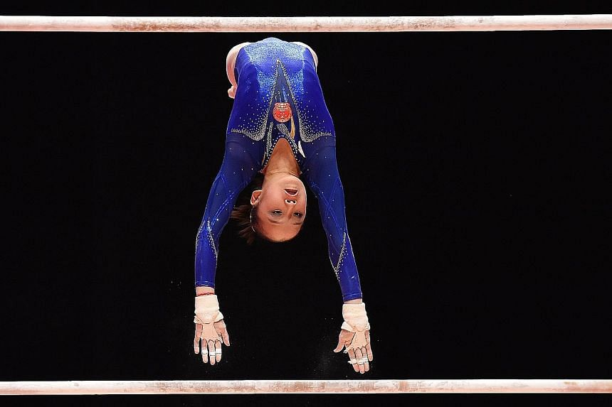 Fan Yilin executed her routine first and had to endure a tense but amusing wait as the scores of three other competitors matched hers in the women's uneven bars final.