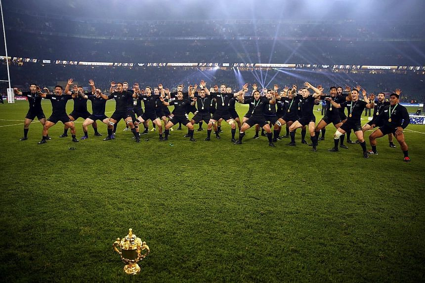 New Zealand perform the haka with the Webb Ellis trophy after winning the World Cup for a record third time on Saturday. They are the first team to retain the trophy.