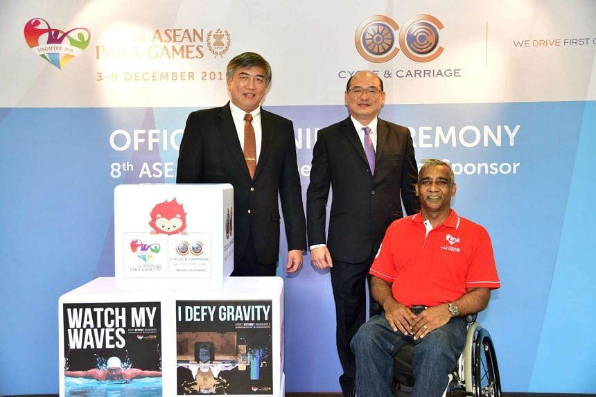 (From left) Mr Lim Teck Yin, Cycle & Carriage's Eric Chan and Singapore Disability Sports Council's Raja Singh at the signing ceremony on Nov 2, 2015.