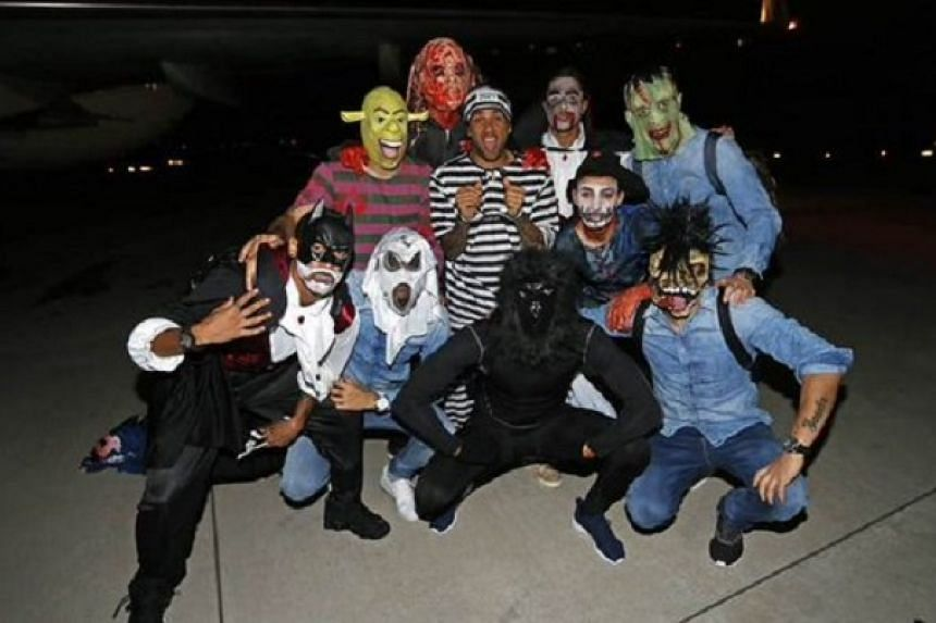 A photo tweeted by FC Barcelona of the players in their Halloween masks.