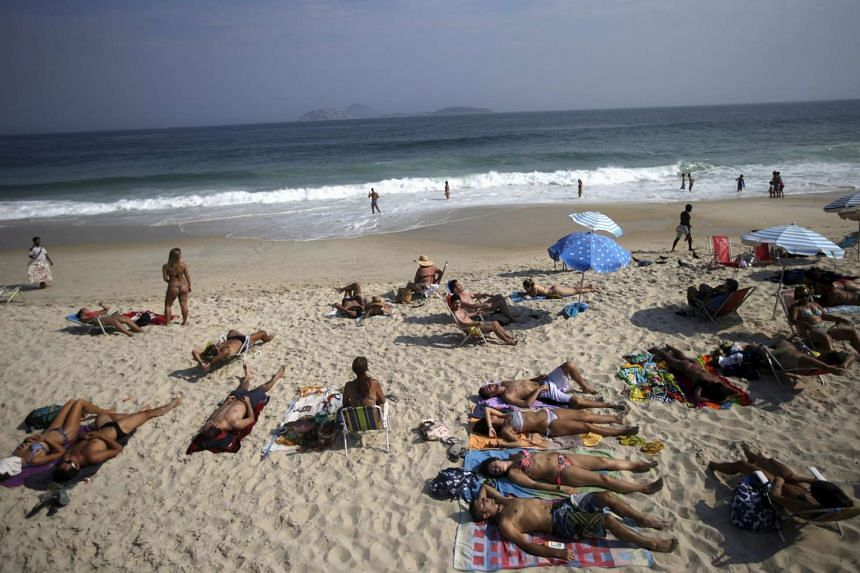 People relax at Ipanema beach in Rio De Janeiro, Brazil.