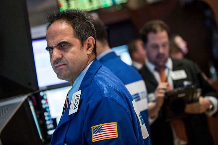 A file picture of a trader on the floor of NYSE. PHOTO:AFP