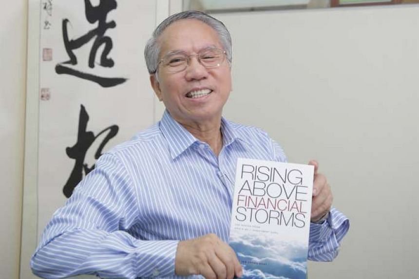 Dr Tan Chong Koay with his new book Rising Above Financial Storms.