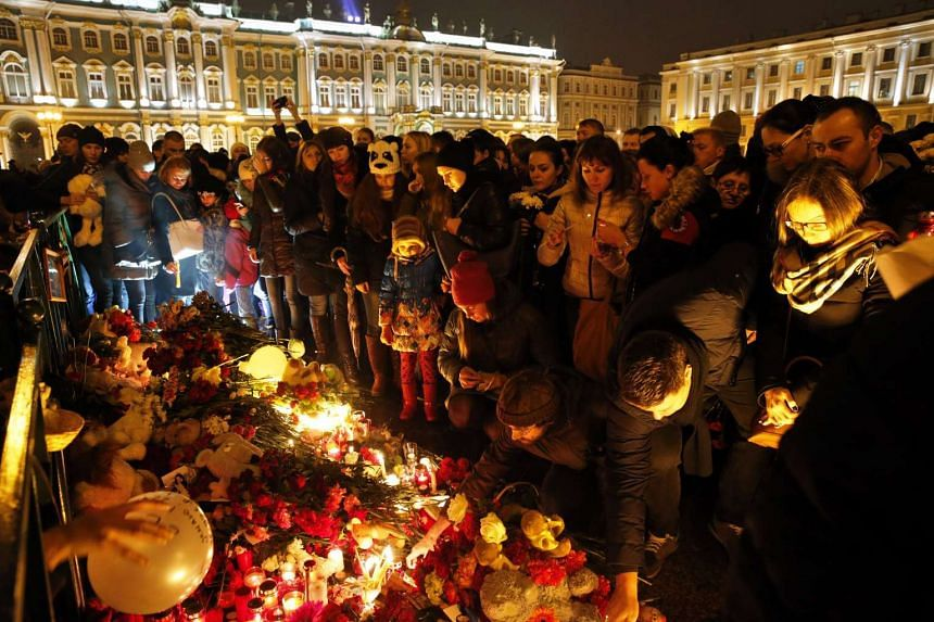 People lay flowers and light candles in memory of the victims of the Russian MetroJet Airbus A321 accident in Sinai, Egypt.