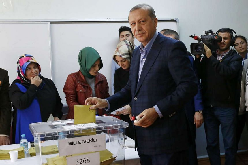 Turkish President Tayyip Erdogan poses as he casts his ballot at a polling station in Istanbul, Turkey.