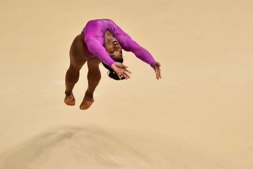 Simone Biles performs during the women's floor final.