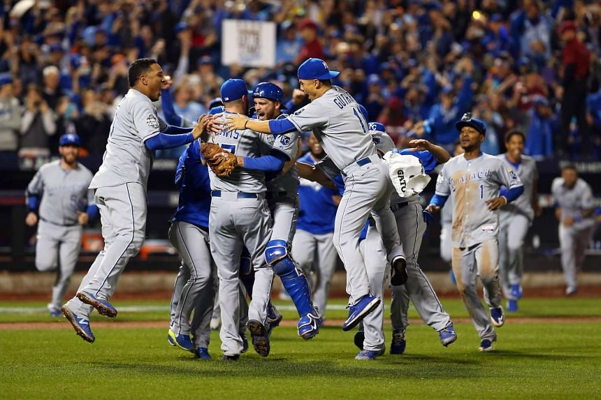 The Kansas City Royals celebrate defeating the New York Mets to win Game Five of the 2015 World Series.